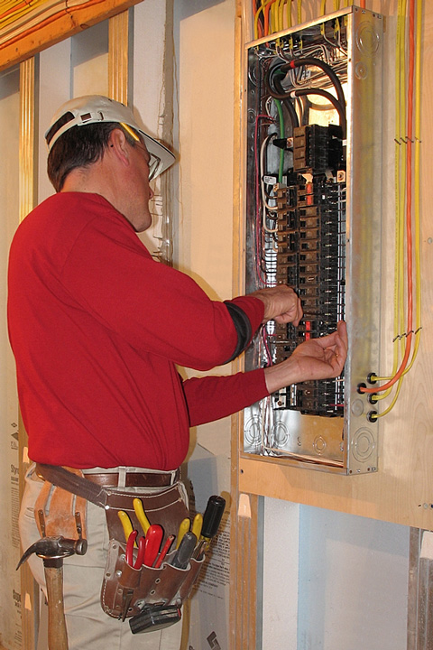 electrician working on an electric panel